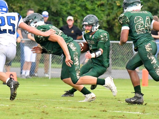 Wilson Memorial's Bryce Norman runs the football during a game played in Fishersville on Wednesday, Sept. 12, 2018.