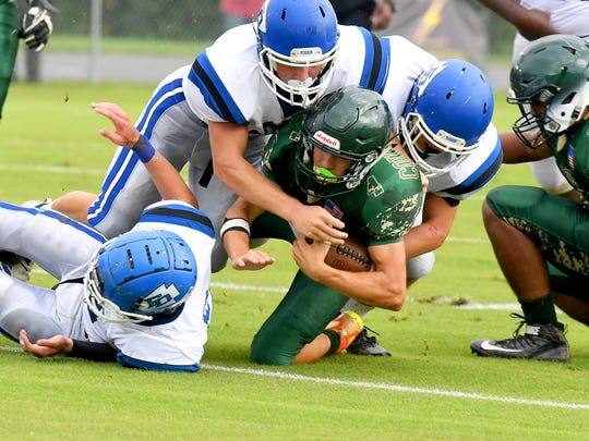 Wilson Memorial's Ty Hevener has the ball as he is forced to the ground by the Fort Defiance defense during a game played in Fishersville on Wednesday, Sept. 12, 2018.