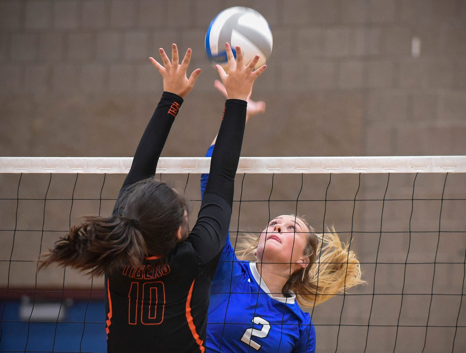 Tech's Ana Rivera goes up to block a spike by Sartell's Alexis Nygaard during the first game Tuesday, Sept. 11, in Sartell