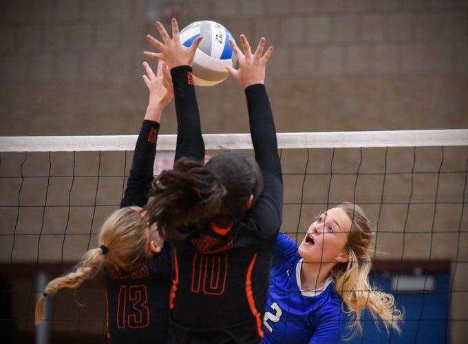 Tech's Megan Raygor and Ana Rivera try to block a spike by Sartell's Alexis Nygaard during the third game Tuesday, Sept. 11, in Sartell.