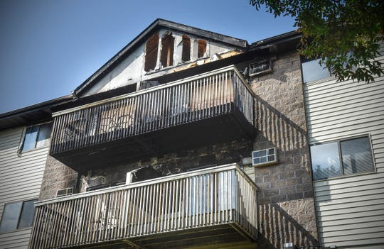 Fire damage is shown Wednesday, Sept. 12, on an apartment building at 327 Seventh Ave. S in St. Cloud.