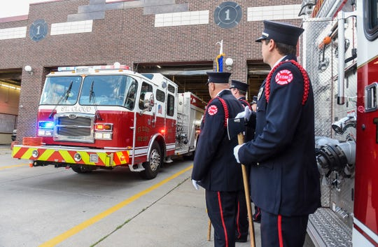 Ceremonial unit members watch as a St. Cloud fire truck leaves on a call in 2017 at St. Cloud Fire Station 1 in downtown St. Cloud.