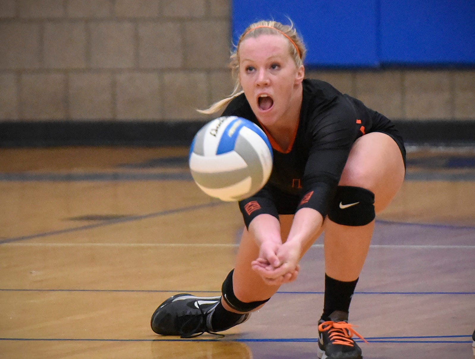 Tech's Rachel Honer dives to bump the ball up against Sartell during the second game Tuesday, Sept. 11, in Sartell
