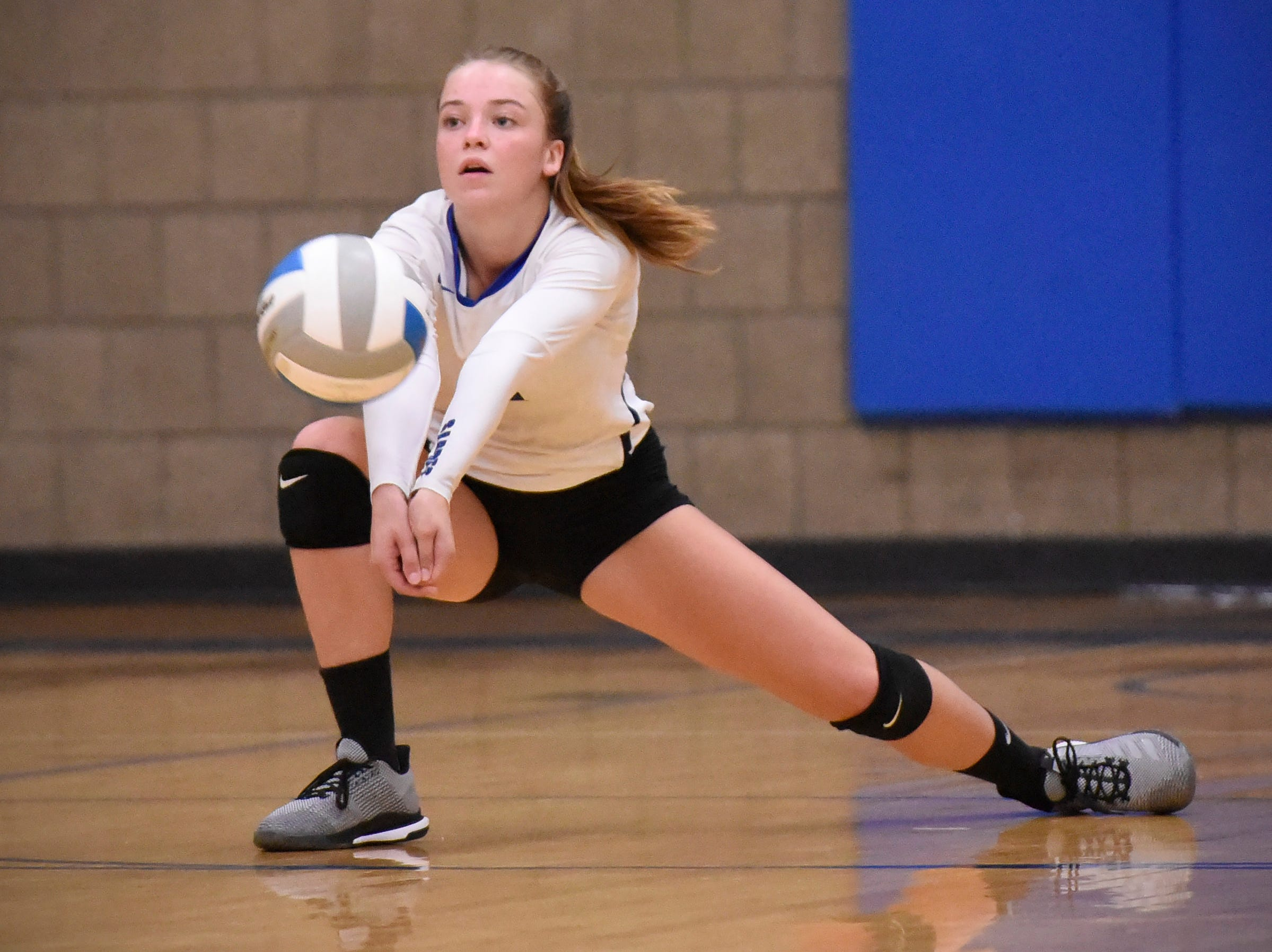 Sartell's Hope Grasswick bumps the ball up during the first game.