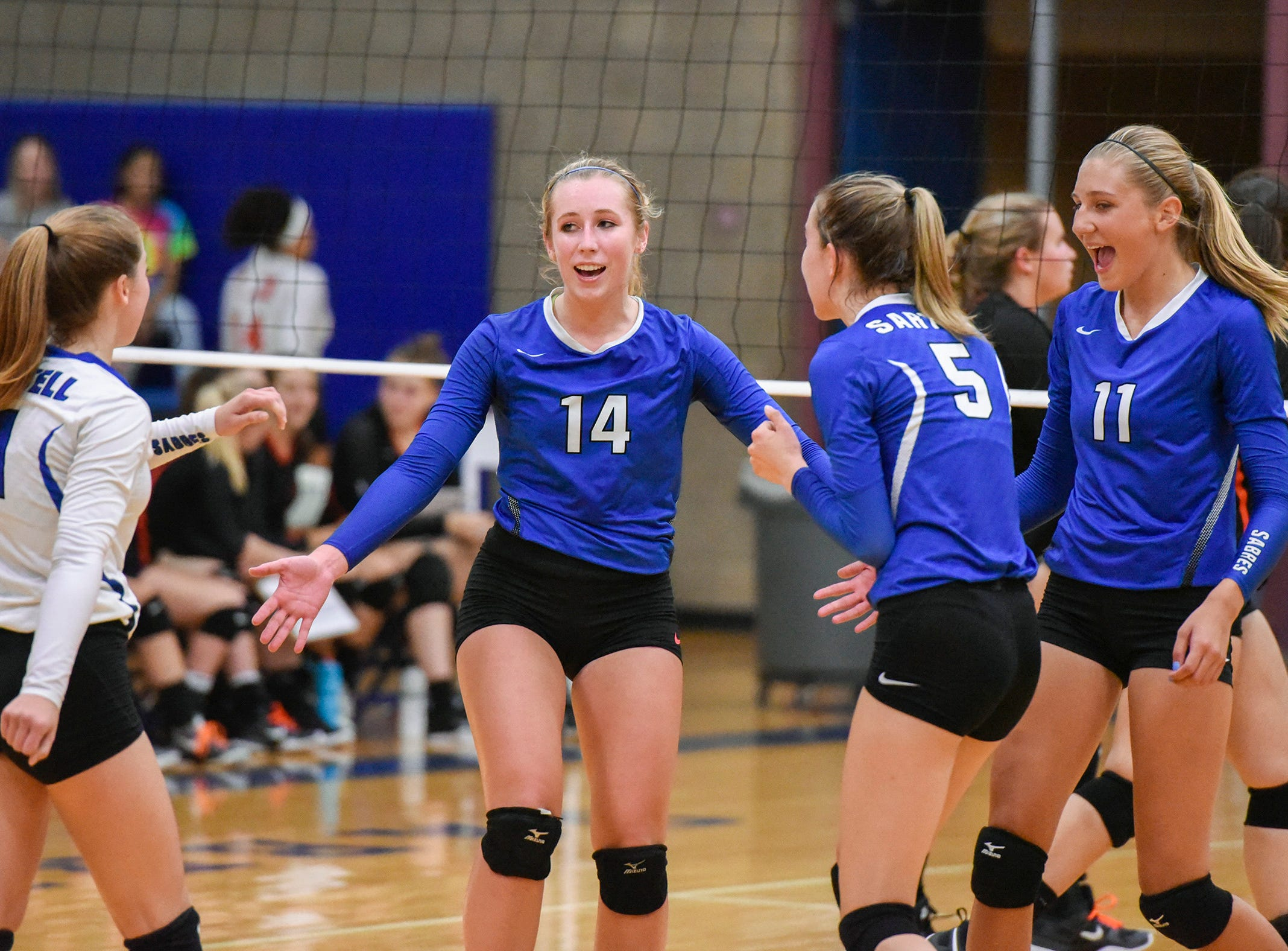 Sartell's Miah Gessell, 14, celebrates a point against Tech during the second game Tuesday, Sept. 11, in Sartell
