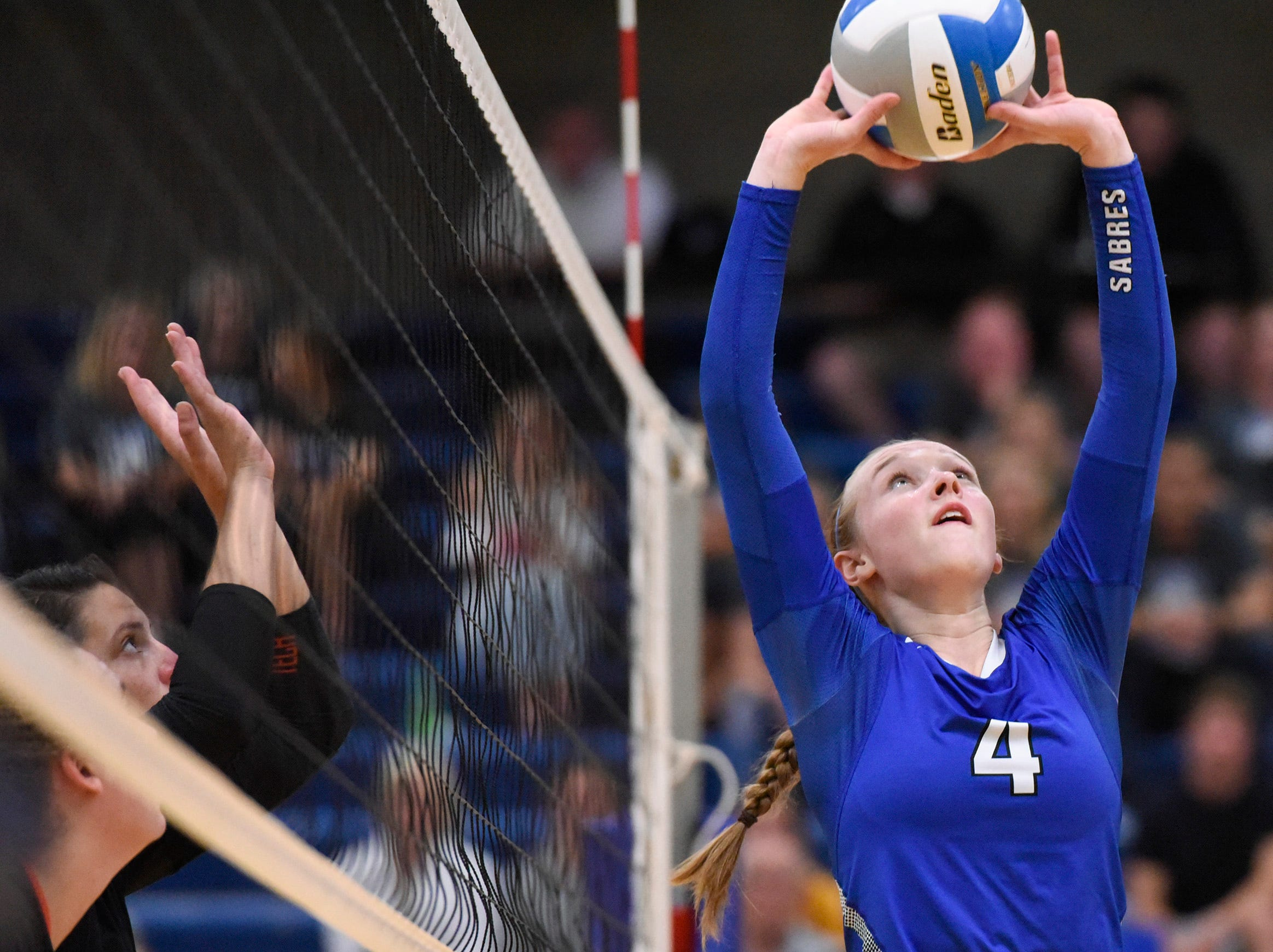 Sartell's Morgan Vosberg sets the ball at the net against Tech during the first game.