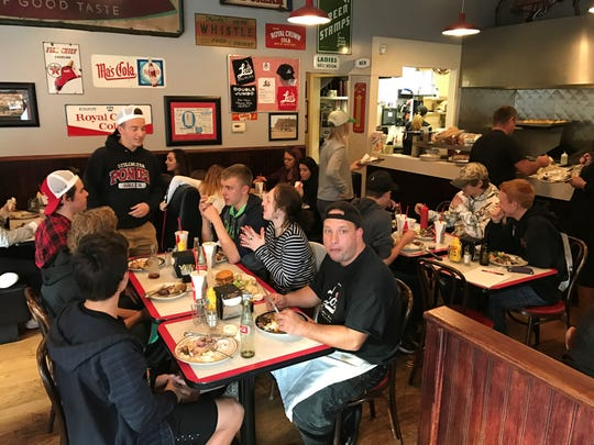 People enjoy their burgers, fries and shakes at Leo's Grill & Malt Shop in Stillwater, Minn.