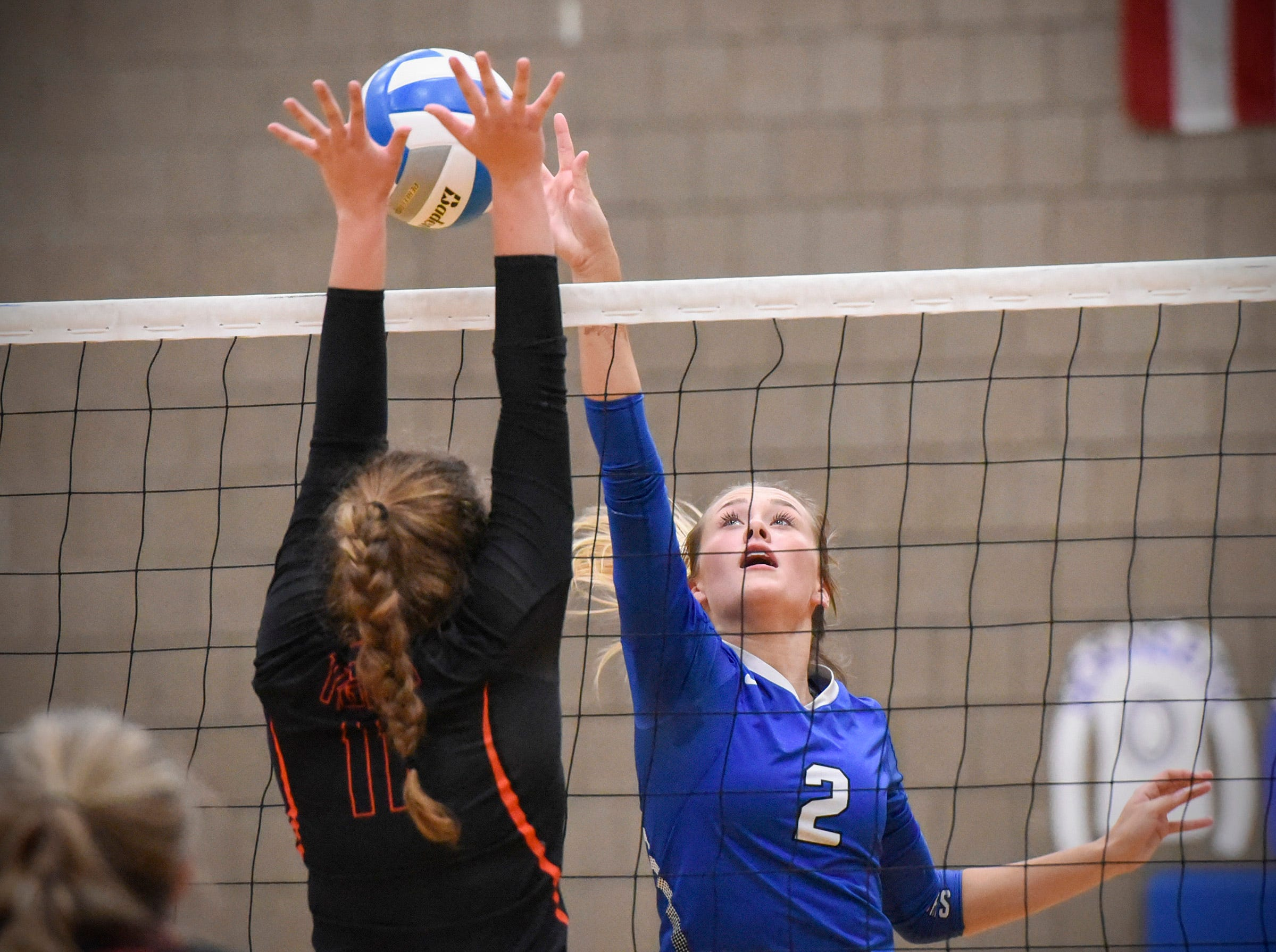 Sartell's Alexis Nygarrd, 2, tries to tip the ball past Tech's Karissa Lintgen during the first game Tuesday, Sept. 11, in Sartell