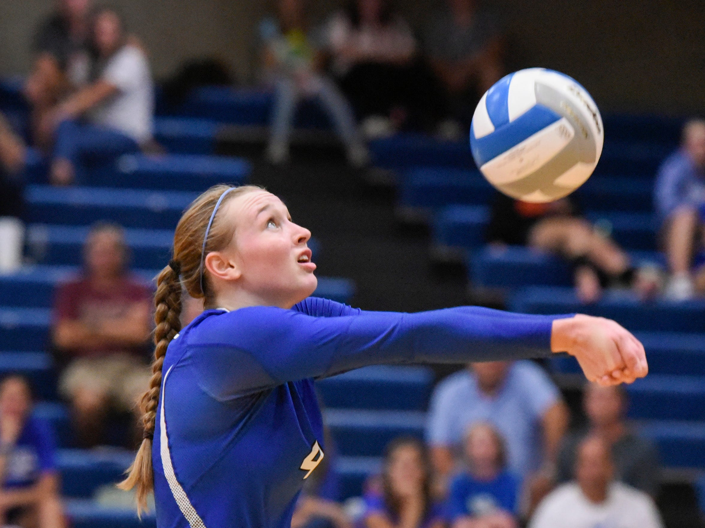 Sartell's Morgan Vosberg bumps the ball toward the net against Tech during the third game Tuesday, Sept. 11, in Sartell.