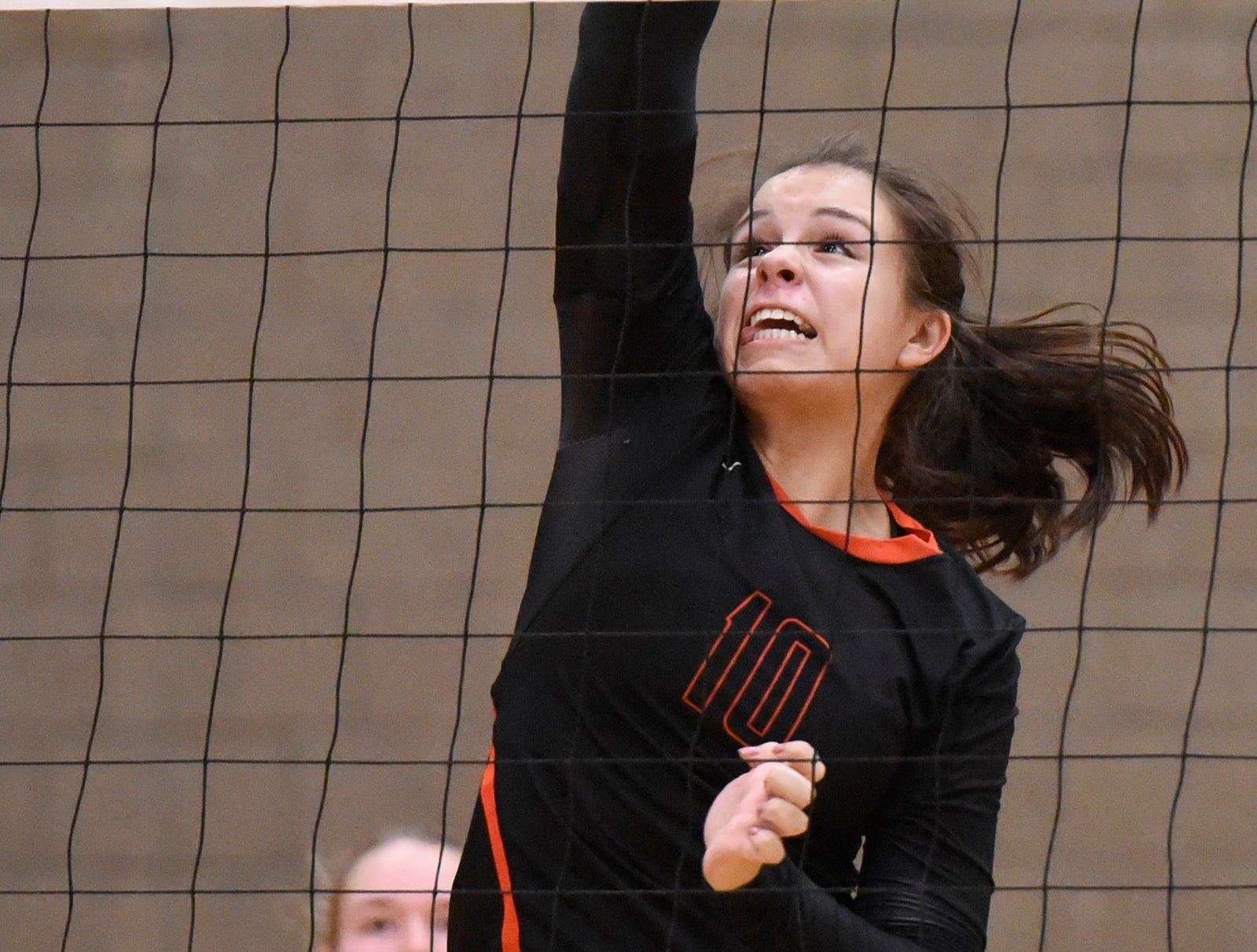 Tech's Ana Rivera spikes the ball over the net during the second game.
