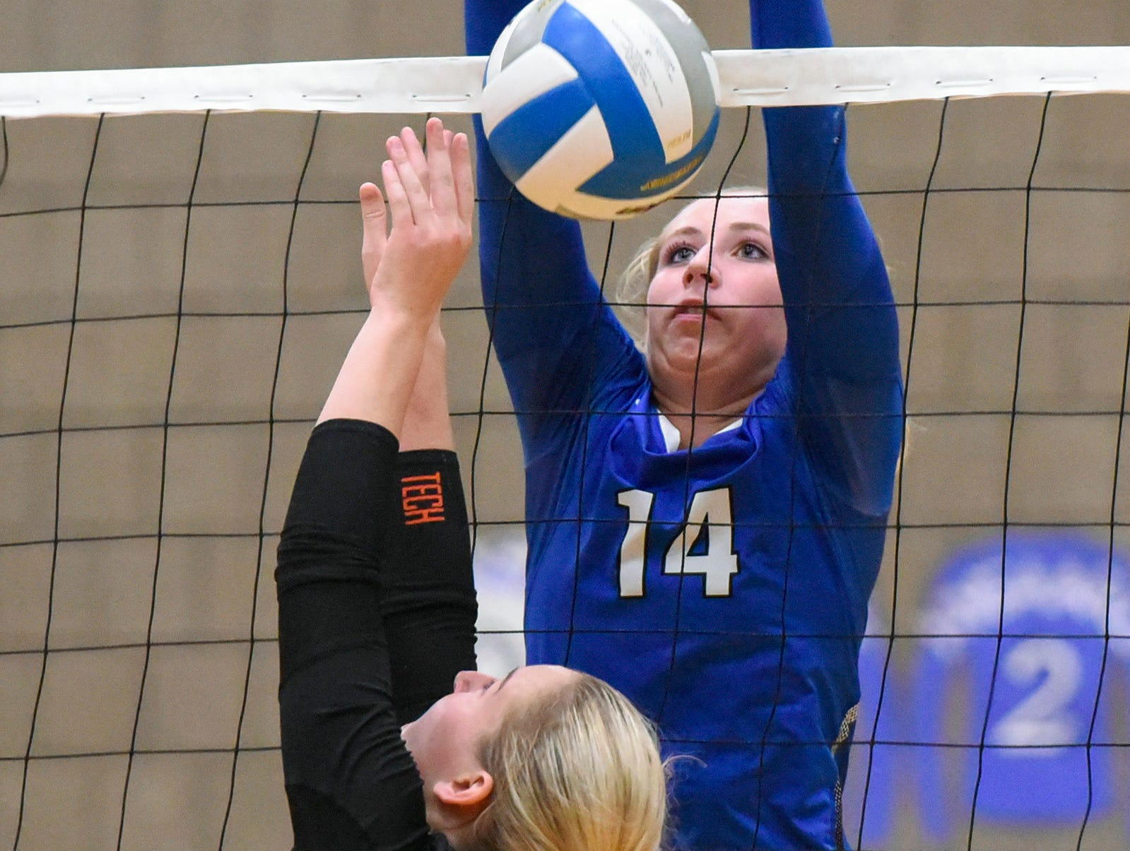 Sartell's Miah Gessell, 14, goes up to block a shot by Tech's Sydney Poepping during the first game Tuesday, Sept. 11, in Sartell