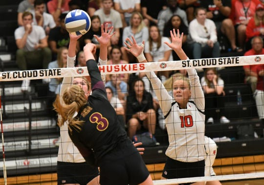 A block for the St. Cloud State volleyball team during its NSIC win over sixth-ranked Minnesota-Duluth on Tuesday at Halenbeck Hall.