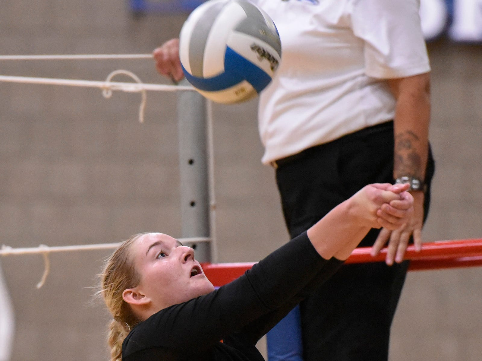 Tech's Sydney Poepping bumps the ball over the net during the first game.