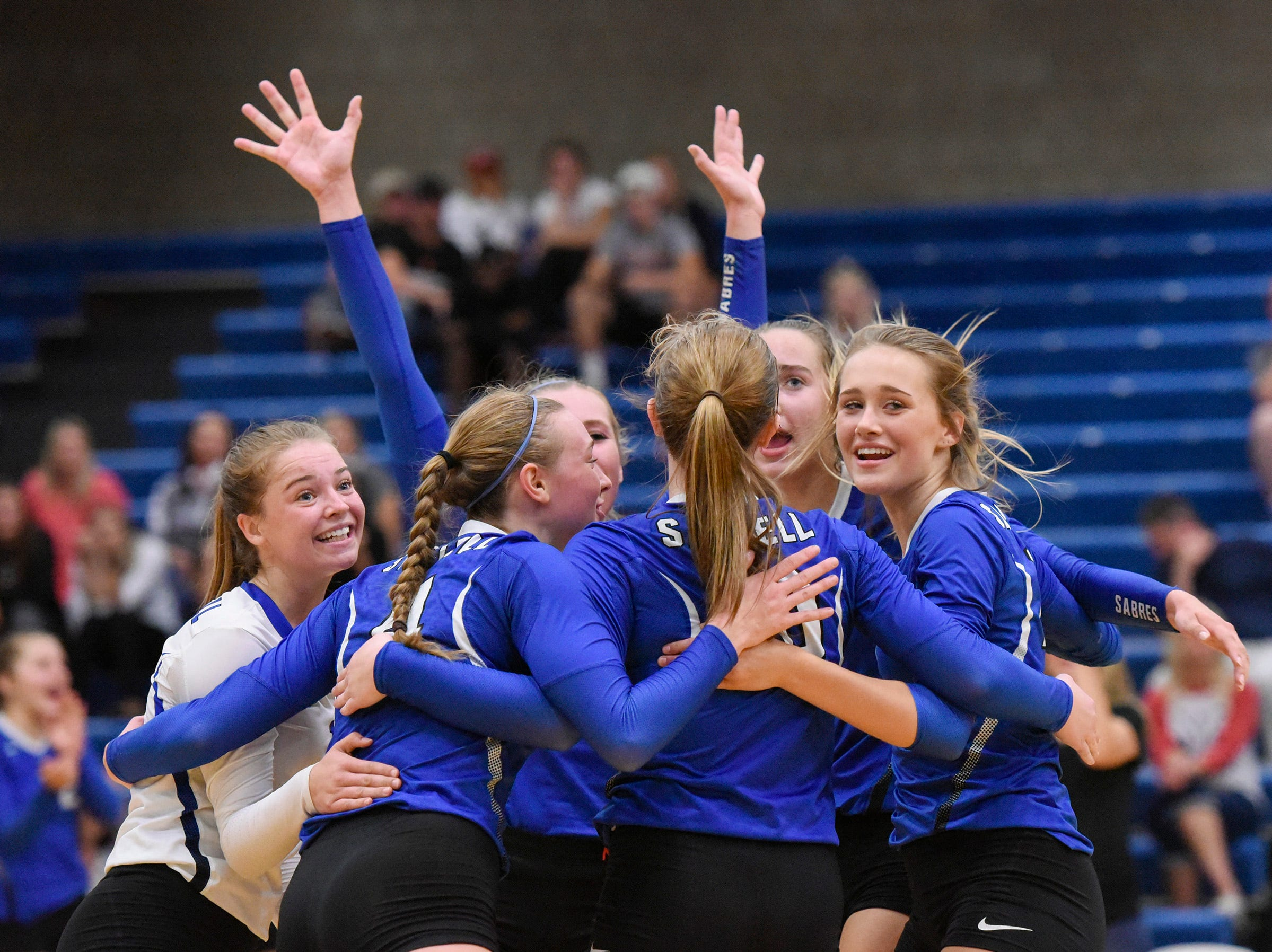 Sartell players celebrate a point against  Tech during the second game Tuesday, Sept. 11, in Sartell