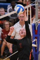 Tech's Sydney Poepping spikes the ball over the net against Sartell during the second game Tuesday, Sept. 11, in Sartell