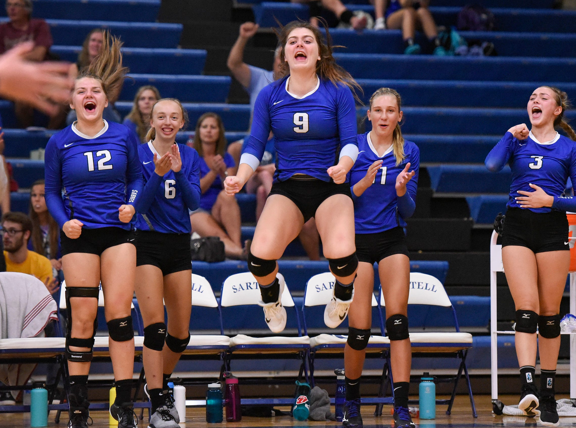 Sartell players come off the bench in the team's win over Tech Tuesday, Sept. 11, in Sartell.