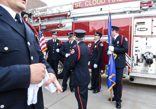 Ceremonial unit members gather for a group photograph in 2017 at St. Cloud Fire Station 1 in downtown St. Cloud.