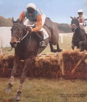 Jimmy Duggan riding Aonoch in one of his many career steeplechase races.