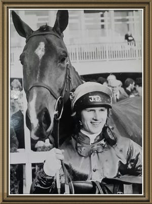 Steeplechase jockey Jimmy Duggan with a horse during one of his many race days.