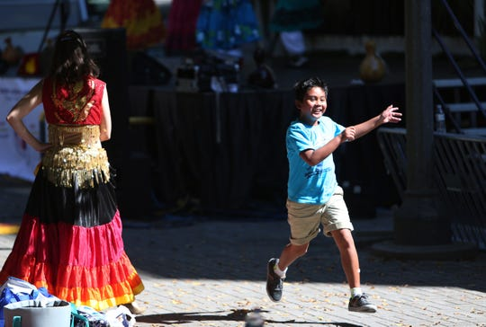 Residents of Asian descent and cultural enthusiasts enjoy songs and dances from the Phillipines as part of the annual Pista Sa Nayon Filipino festival. This year's event is set for Saturday at Kleman Plaza.
