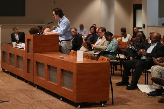 A community member speaking at the new podium set-up in City Hall for the Community Redevelopment Agency meeting on September 12, 2018.