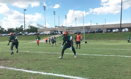 FAMU defensive back Terry Jefferson sizes up the offense formation during practice.
