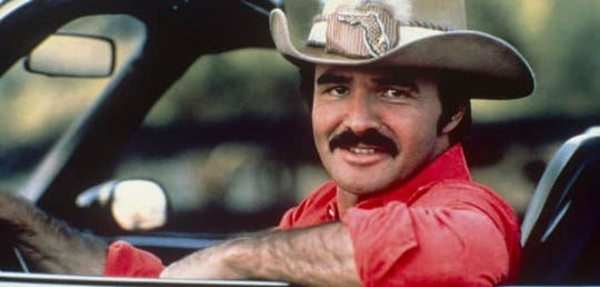"""This is what the late Burt Reynolds looked like when he starred in the 1977 film """"Smokey and the Bandit."""" Reynolds died Sept. 6, 2018. He was 82 and born in Lansing, Mich."""