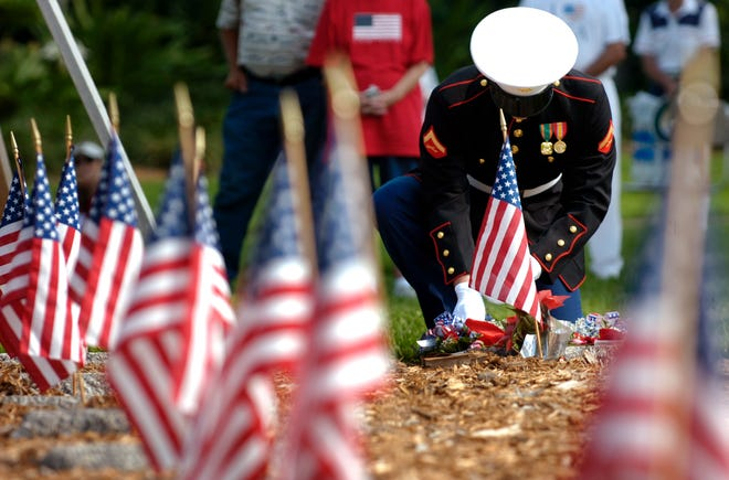 May 29, 2006 - U.S. Marine John Bissonnette placed a wreath on the marker of Ronald Scott Owens who was killed October 12, 2000, when the USS Cole was attacked in Yemen's harbor of Aden. The ceremony took place on Memorial Day at Veterans Memorial Island Sanctuary.