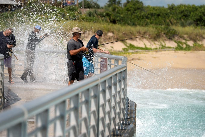 "Tony Skinner, of Orlando, endures the spray from crashing waves while fishing from the north jetty on Wednesday, Sept. 12, 2018 at Sebastian Inlet State Park. ""I doesn't really bother me getting hit in the face with water while I'm out here,"" Skinner said. ""It's just part of fishing at the pier."" The jetty will be closed from Wednesday night to Thursday afternoon due to large waves predicted in the inlet, according to the website for the Sebastian Inlet District. Wave heights for the inlet are forecast to reach up to 12 feet during the overnight hours and into Thursday, due to a high pressure ridge over the Florida peninsula caused by Hurricane Florence as it approaches the eastern United States."