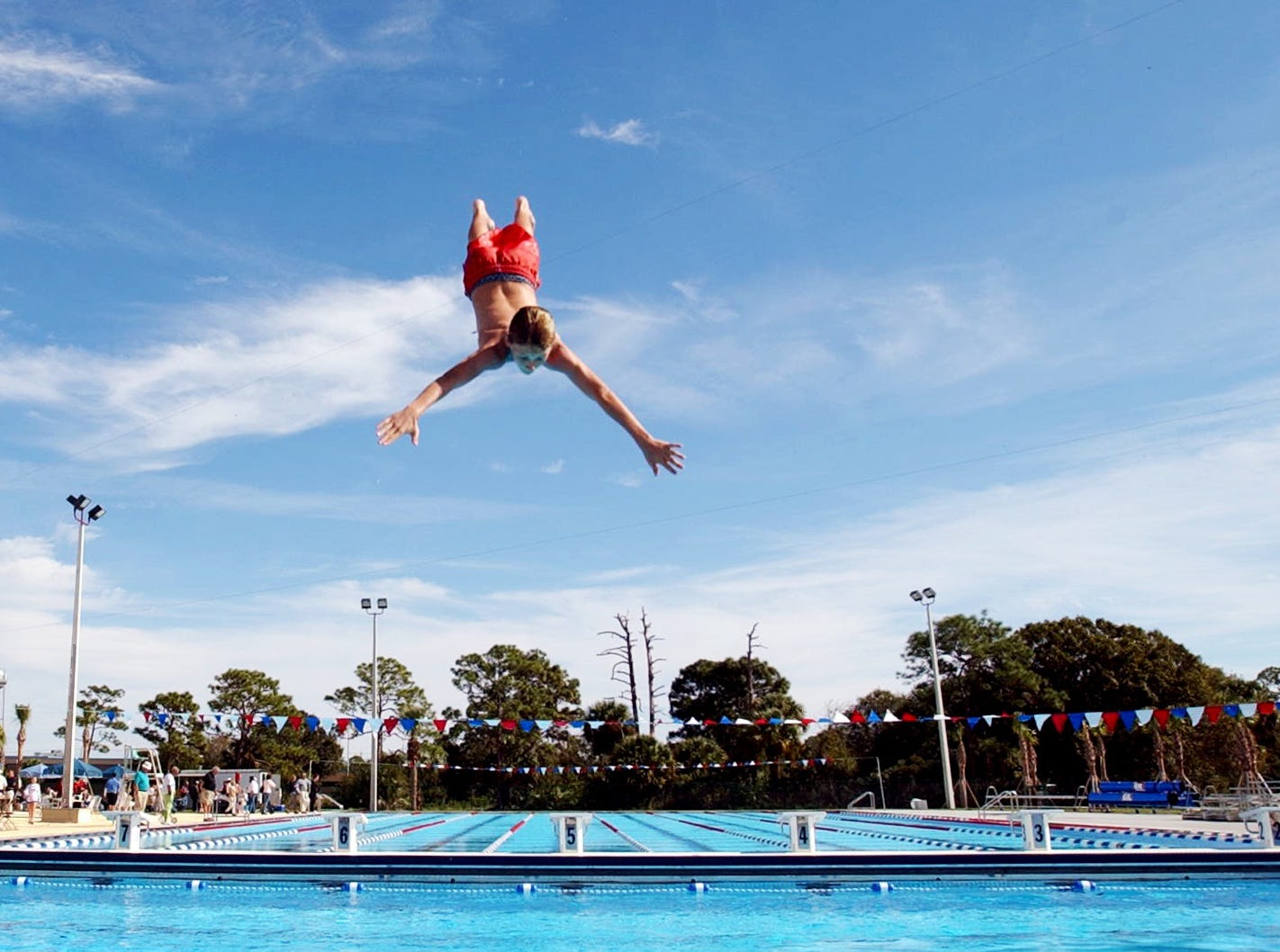 November 30, 2002 - Tyler Saghy, 13, a seventh-grader at Sebastian River Middle School, helps inaugurate the new pool in North County Regional Park with a back flip from the high diving board. The Olympic-size pool is 16,314 square feet and holds 930,000 gallons of water. During construction, the Olympic pool was destroyed earlier in the year by storms and had to be rebuilt.