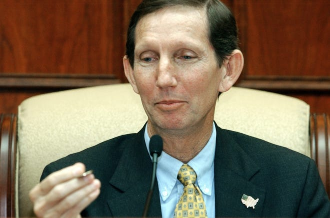 March 13, 2002 - Craig Fletcher looks at a coin that was tossed to decide whether he or Tom White would be the mayor during an organizational meeting at the City Hall the day after the election. White swept the votes for his re-election to the Vero Beach City Council but lost his re-election as mayor to Craig Fletcher by the toss of a coin, thrown by Vero Beach businessman Craig Long. Fletcher gained the title 20 years after his father, Alfred Fletcher, served as Vero Beach mayor.