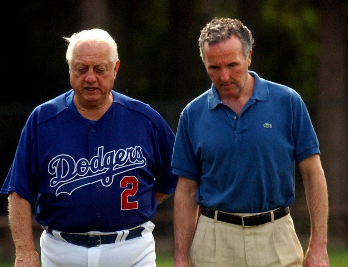 February 24, 2004 - Tommy Lasorda and new Los Angeles Dodgers chairman, Frank McCourt chat after a team meeting at Dodgertown. McCourt bought the Dodgers on January 29, 2004.