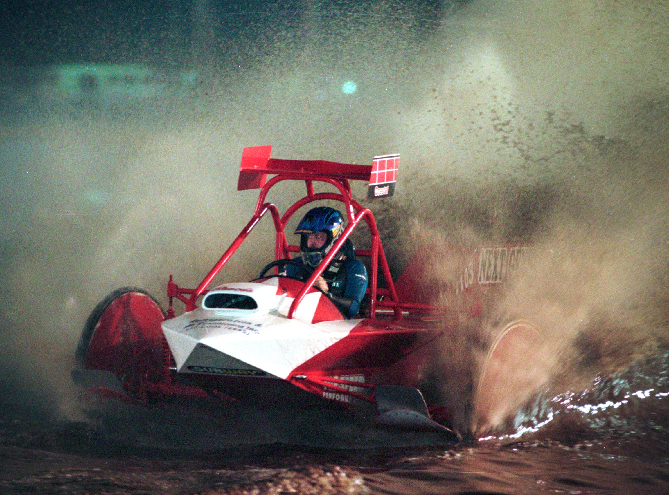 January 15, 1999 - MESA Park opened its track to swamp buggy racing in Fellsmere. Fans would have to go to Naples to see this type of racing until MESA opened its doors. Leonard Chesser navigates Dats Da One through the swamp track at MESA Park during their grand opening competition. Chesser had been driving since 1970 and racked up 17 victories since he started the sport.