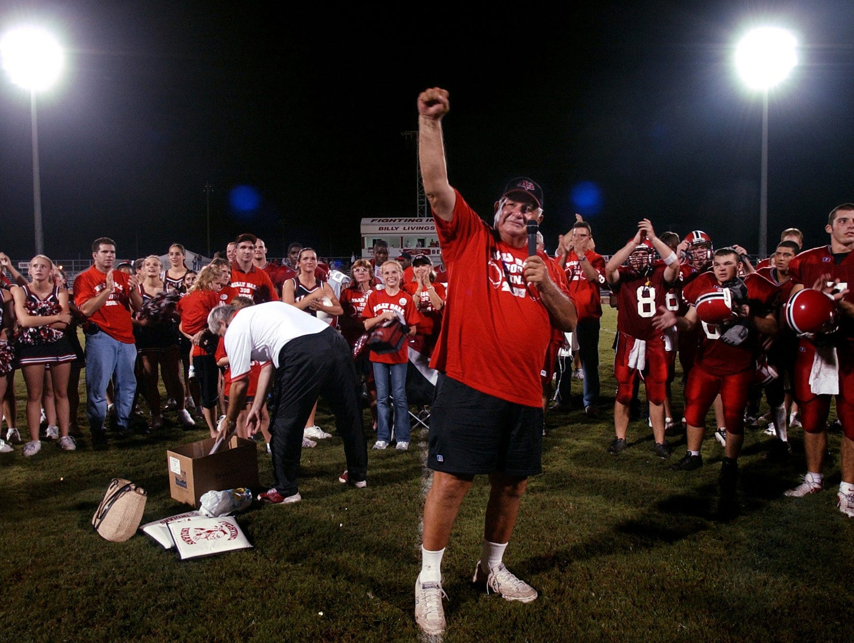 October 2, 2003 - Vero Beach High School head football coach Billy Livings gives a short speech thanking fans, family, coaches, players and everyone else who supported the football team during a celebration for Livings' 300th victory as head coach after the Indians defeated Wellington High School 20-0 at home.