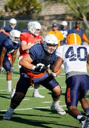 UTEP offensive lineman Ruben Guerra (61) looks downfield as the team goes through practice Wednesday morning. The Miners continue preparations for their upcoming game against the Tennessee Vols on Saturday morning with kickoff scheduled for 10 a.m. Mountain time in Knoxville, Tenn.