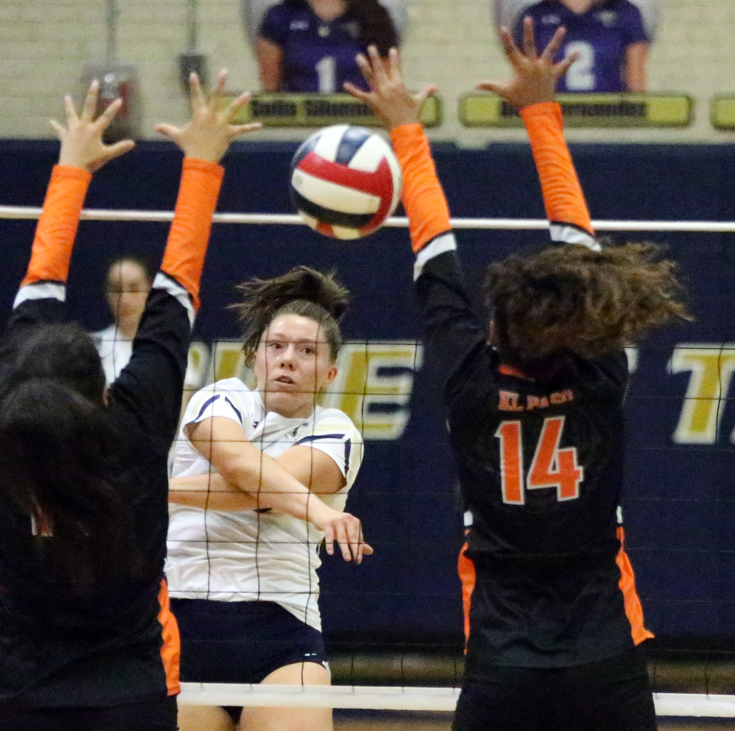 Alyssa Heist, center, fires the ball past El Paso High defenders, including Laura Barrios Bardi, 14, on Tuesday night at Coronado.