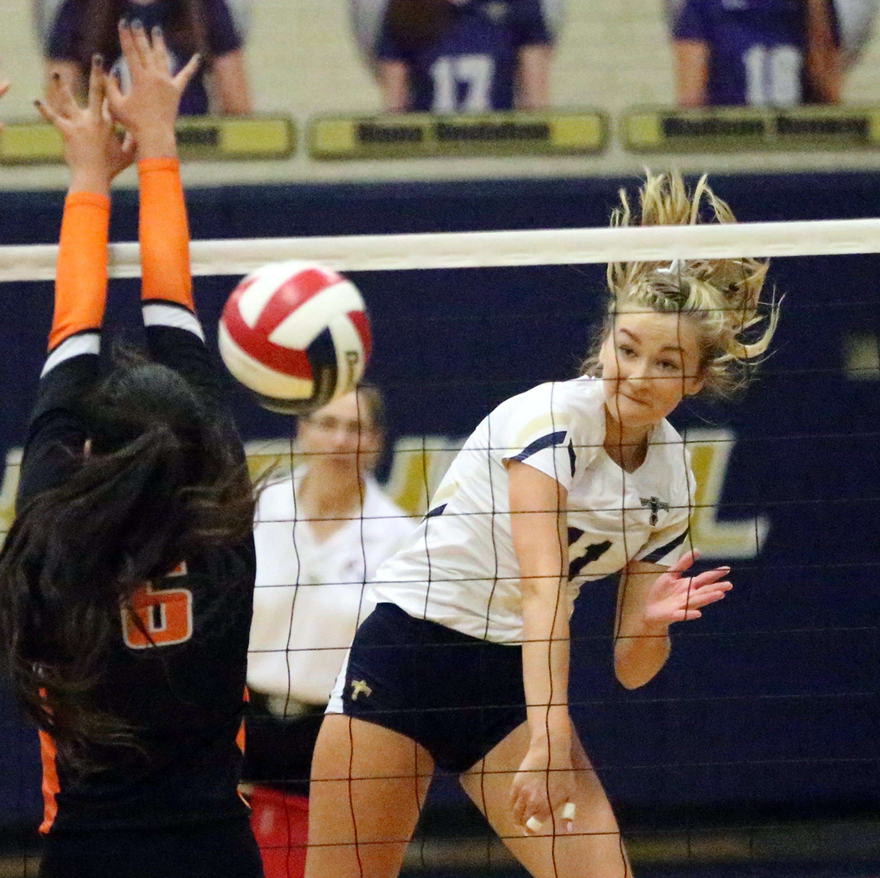 Coronado's Campbell Bowden, 11, fires a shot over the net past Hannah Payan, 6, of El Paso High on Tuesday night at Coronado. The T-Birds won the contest in three sets.