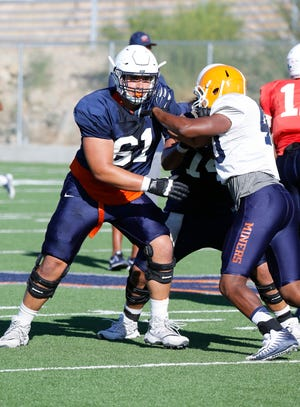 UTEP offensive lineman Ruben Guerra (61) looks downfield as the team goes through practice recently.