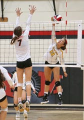 Ventura High senior Olivia Monarres goes up for the spike as Rio Mesa's Camryn Morey attempts the block during Tuesday's match.