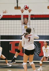 Ventura High senior Olivia Monarres goes up for the block shot during Tuesday's match against Rio Mesa.