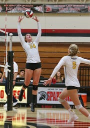 Ventura High's Nevada Knowles (14) sets the ball for Tatum Teel during Tuesday's match against Rio Mesa.