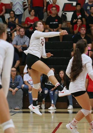 Rio Mesa High's Caitlyn Donart spikes a shot during Tuesday's match against Ventura. The Spartans beat their new Pacific View League rival.