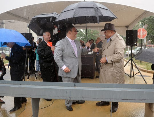 """From left to right, Vineland Police Chief Rudy Beu, Vineland Mayor Anthony R. Fanucci and Vineland Public Safety Director Edwin Alicea prepare to sign a beam during the """"topping Off"""" ceremony for the new $20 million police headquarters on Wednesday, September 12."""