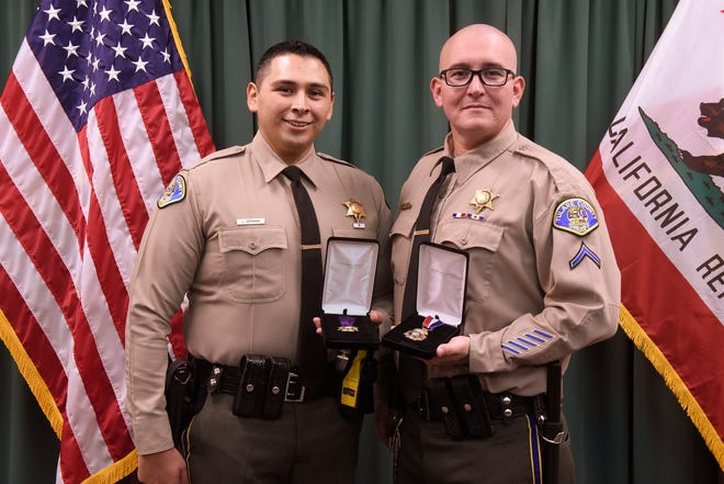Sheriff Mike Boudreaux awarded Dep. Juan Serrano, left,  the Purple Heart and Dep. Daniel Villalobos, right, the Medal of Valor during a special awards ceremony Tuesday, Sept. 11, 2018.