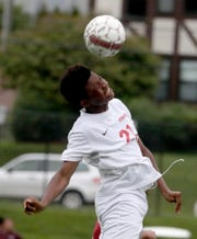 Ketcham's Emmanuel Arubuike heads the ball during a soccer game against Ossining on Sept. 12, 2018.