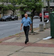 Former Croton-on-Hudson fire chief Gerald Munson leaves the Westchester County Courthouse in White Plains.