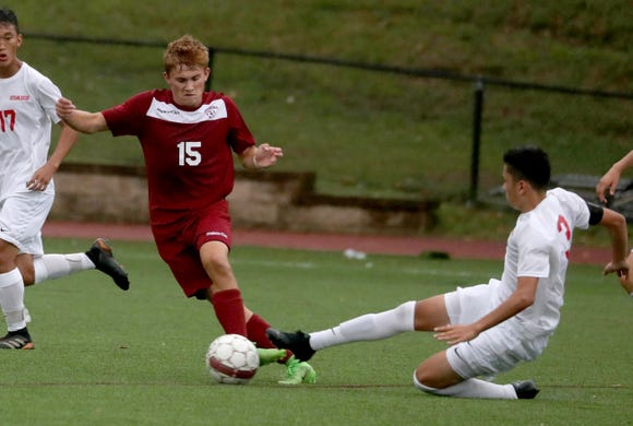 Nolan Lenaghan of Ossining is pressured by Ketcham's John Meza during a varsity soccer game at Ossining High School Sept. 12, 2018. Ossining defeated Ketcham 5-2.