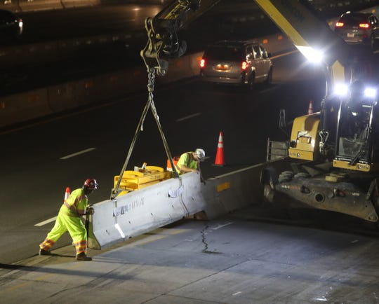 Workers move lane barriers on the eastbound span of the Gov. Mario M. Cuomo Bridge to get it ready to be opened for traffic Sept. 11, 2018.
