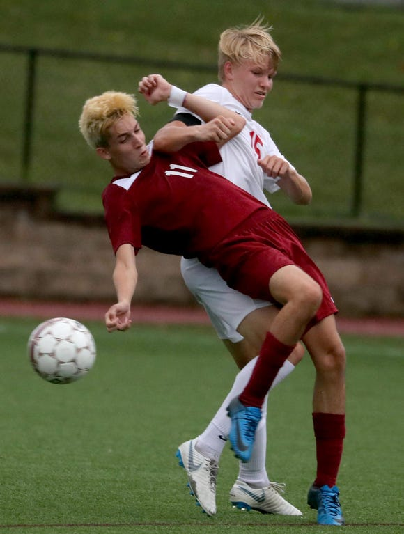 Mateo Marra of Ossining battles Ketcham's Josh Kowalsky during a varsity soccer game at Ossining High School Sept. 12, 2018. Ossining defeated Ketcham 5-2.
