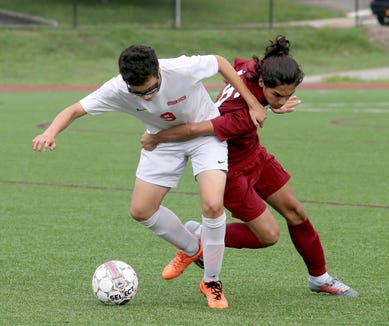 Eric Monges of Ossining battles Ketcham's Sebastian Velasquez during a varsity soccer game at Ossining High School Sept. 12, 2018. Ossining defeated Ketcham 5-2.